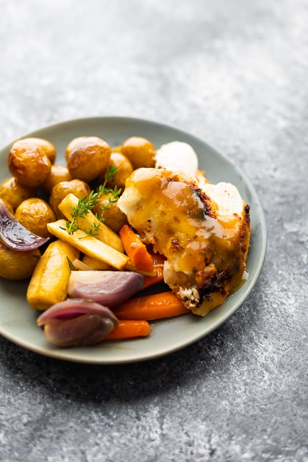 slow cooker whole chicken with vegetables and potatoes on a plate