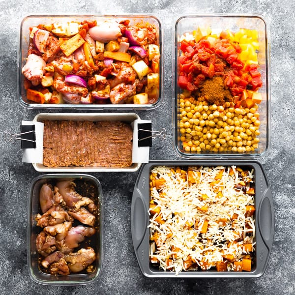 five freezer meals in various sized containers