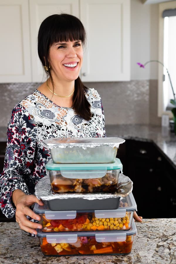 Denise with a stack of 5 freezer meals
