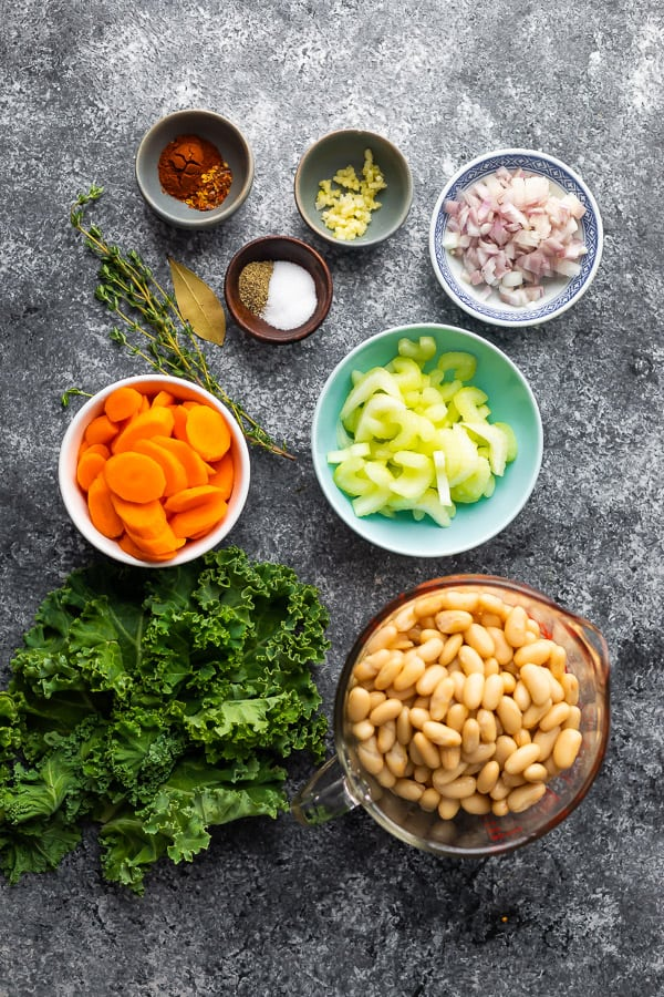 overhead view of ingredients required for white bean kale soup