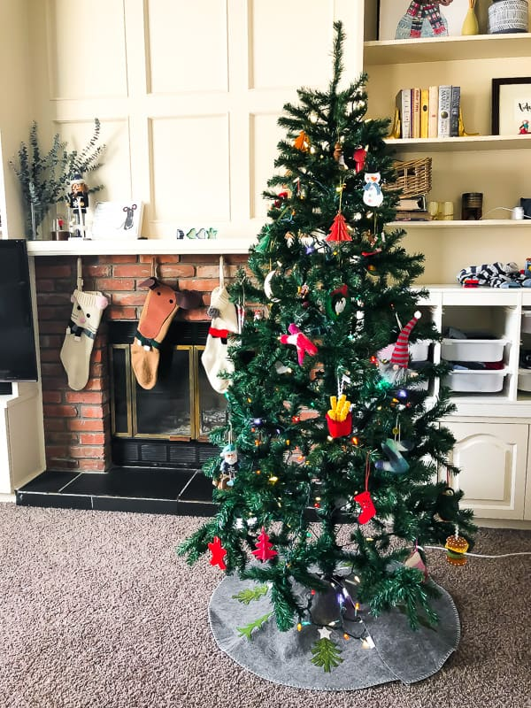 christmas tree with stockings in background