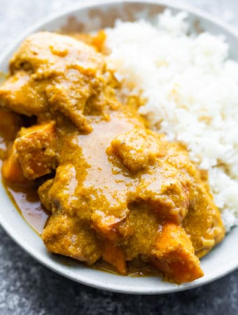 close up shot of chicken korma with sweet potato and rice