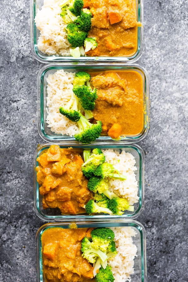healthy chicken korma portioned out in meal prep containers