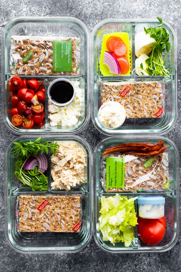 overhead shot of glass meal prep containers with 4 bento lunch box ideas