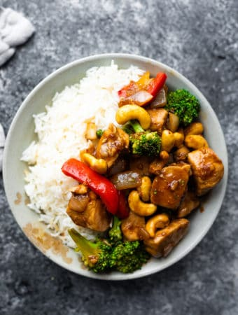 overhead shot of gray bowl filled with maple ginger cashew chicken stir fry