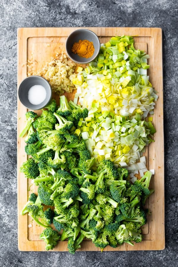 ingredients required for the keto broccoli soup on cutting board