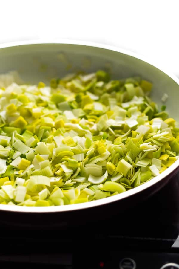 sauteeing leeks for the vegan broccoli soup in pan