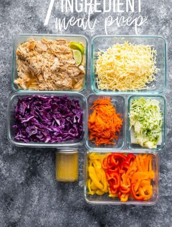 Overhead shot of various food containers filled with fresh ingredients for the 7 ingredient meal prep plan