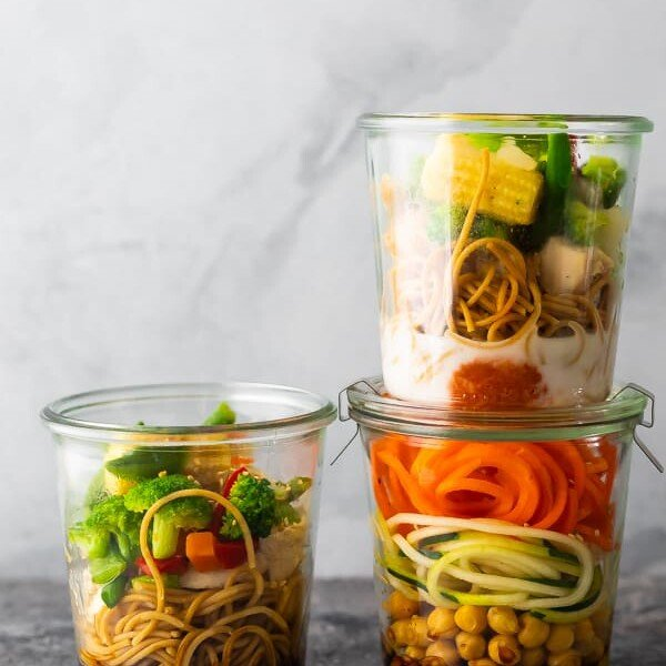 three jars with homemade instant noodles on gray background