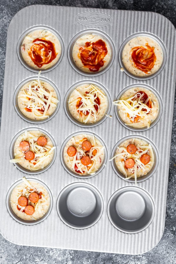 pizza puffs in muffin tin before baking