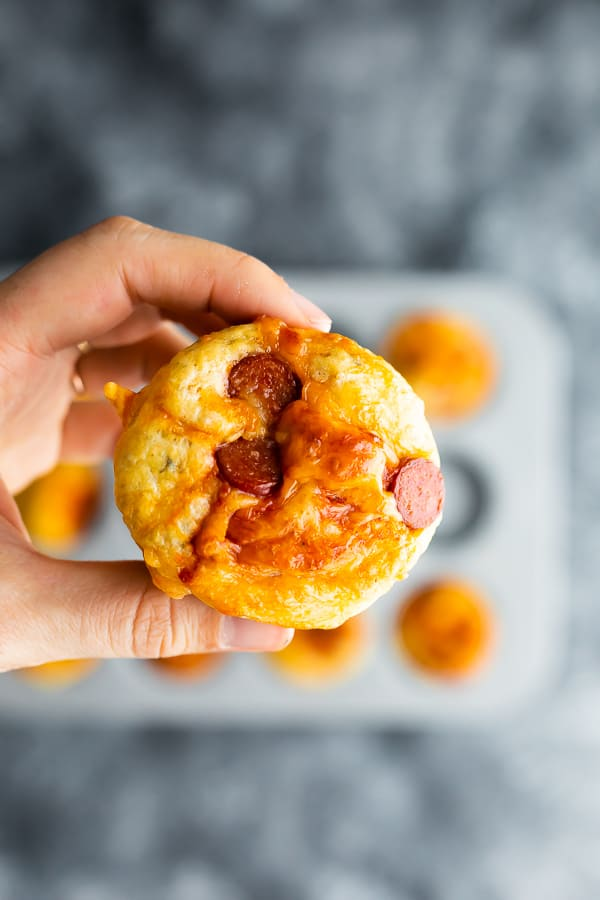 pizza puff in hand