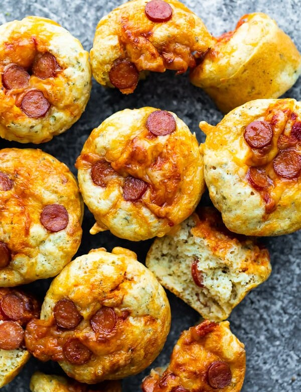 overhead shot of many cheesy pepperoni pizza puffs
