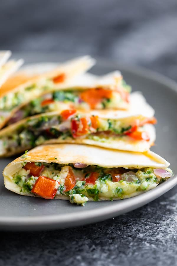 close up side angle of the spinach feta breakfast quesadillas showing the gooey filling