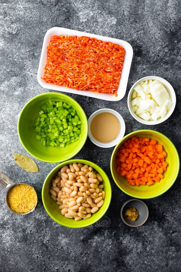 overhead view of the ingredients required for sausage orzo soup