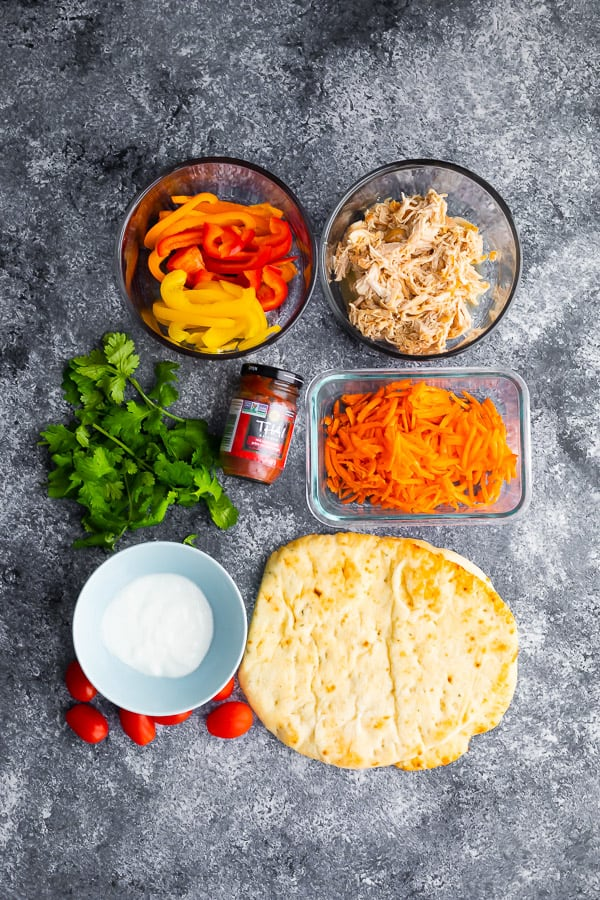 overhead view of ingredients required for thai chicken pizza