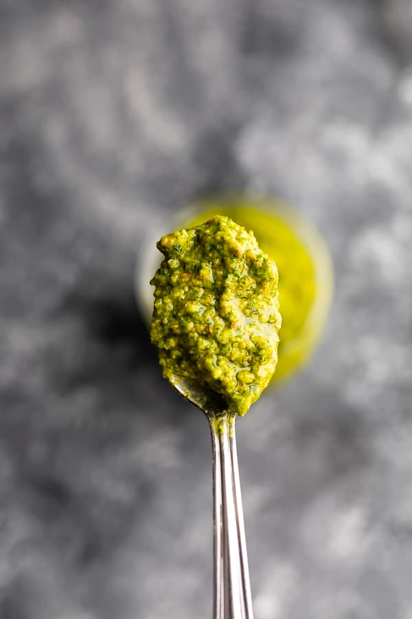 Close up shot of mint and pistachio pesto on a spoon