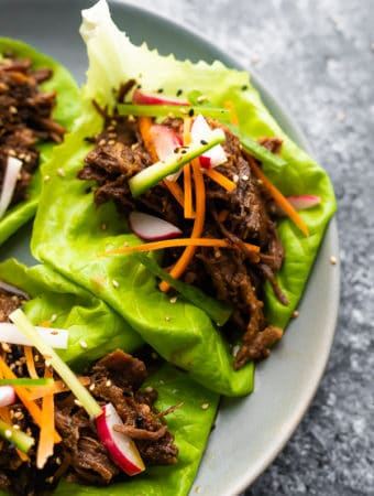 Korean beef lettuce wraps on a gray plate