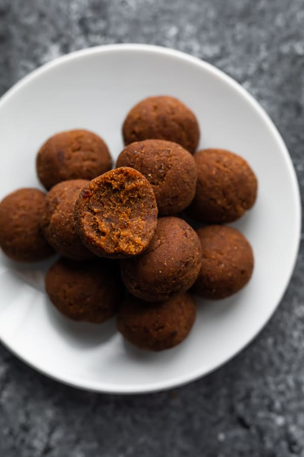coconut date balls on a plate