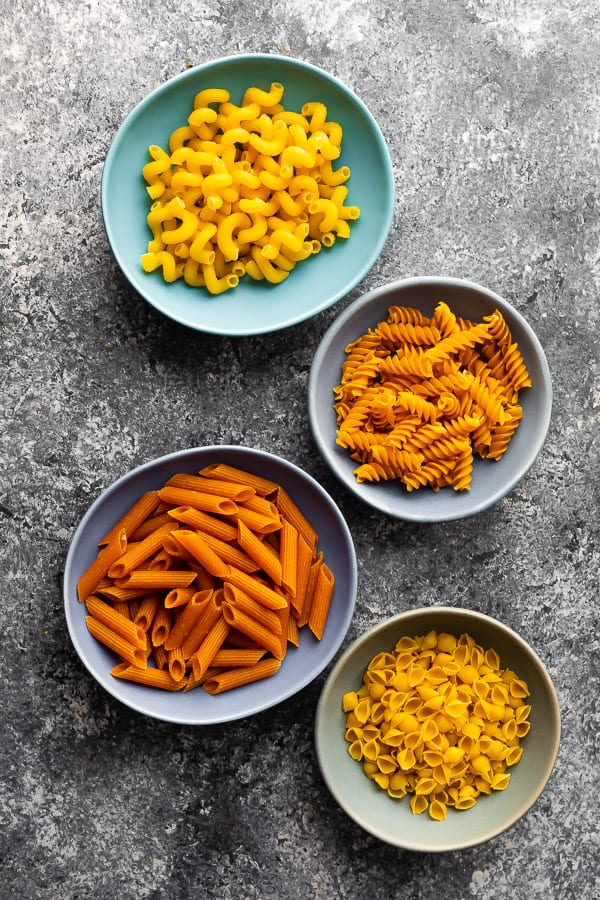 four bowls of different pasta shapes