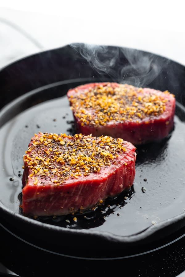cooking steaks in a cast iron pan