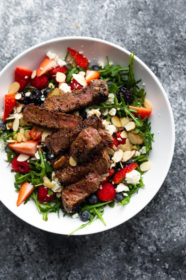 Strawberry Steak Salad in white bowl