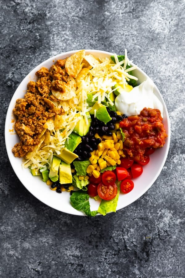 overhead view of healthy taco salad in white bowl