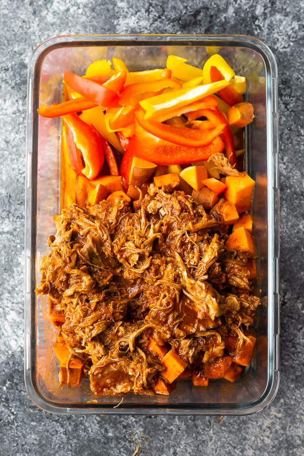ingredients for pulled pork sweet potato skillet in meal prep container