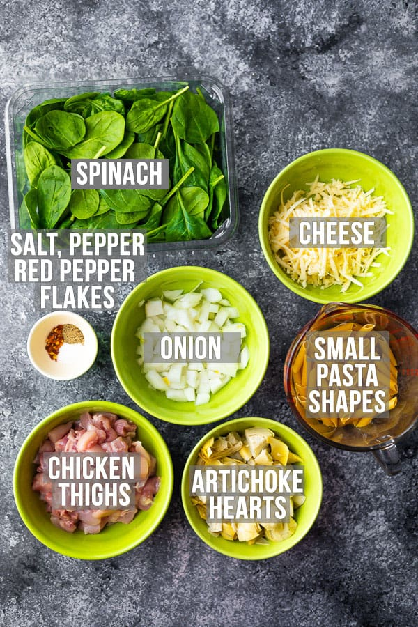overhead view of the ingredients needed to make spinach artichoke pasta