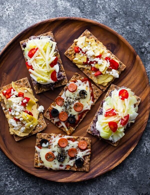 open-faced sandwiches on wooden platter