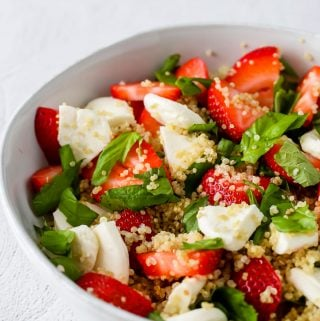 close up side angle shot of strawberry caprese quinoa salad