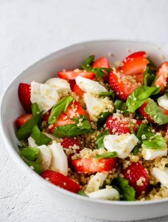 close up side angle shot of strawberry caprese quinoa salad