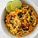 overhead shot of sweet potato noodles with avocado sauce in a bowl