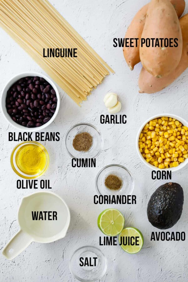 overhead view of ingredients required to make sweet potato noodles with avocado sauce
