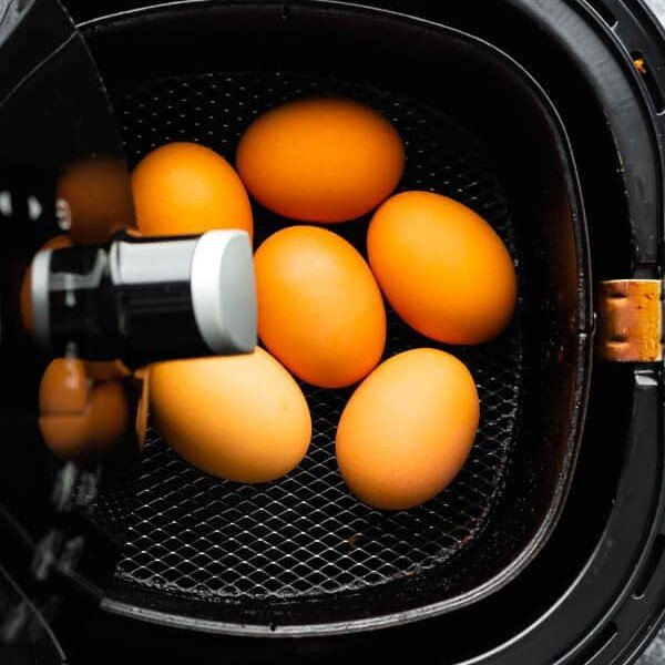 overhead view of eggs in an air fryer basket