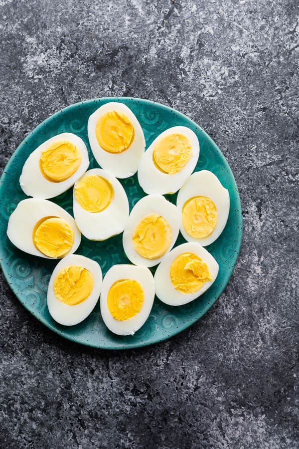 plate with 10 hard boiled egg halves on it