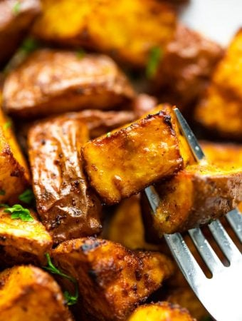 close up view of air fryer roasted potatoes on fork