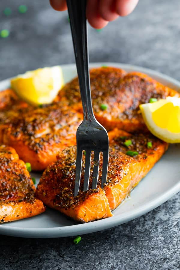fork flaking into a portion of air fryer salmon