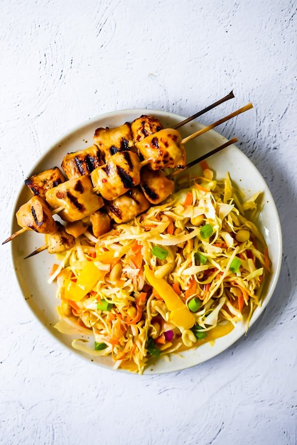 overhead view of chicken satay salad on a plate