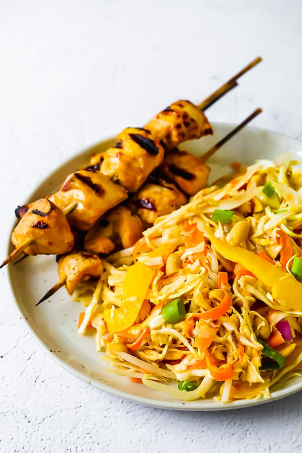 side angle view of chicken satay salad on a plate