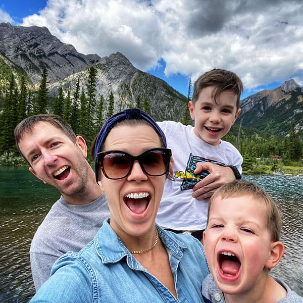 Denise Bustard with her family in the mountains