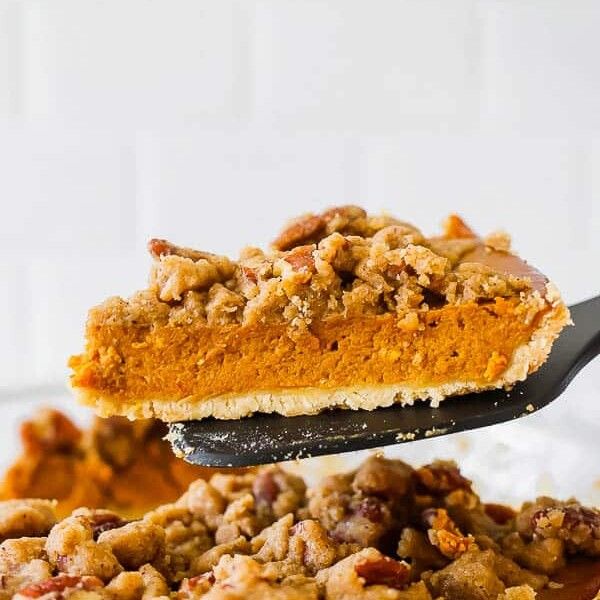 slice of pumpkin pie on a spatula