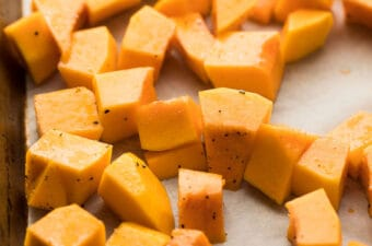 cubed butternut squash on baking sheet