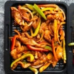 air fryer chicken fajitas on tray before cooking