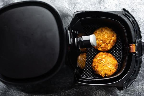 salmon patties cooked through in air fryer basket