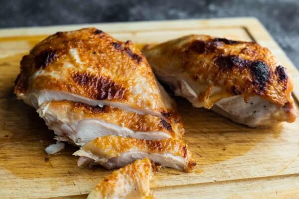 sliced turkey breast on cutting board