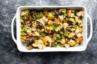 leek and mushroom stuffing in casserole dish before baking