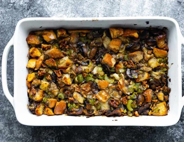 overhead view of leek and mushroom stuffing in white casserole dish