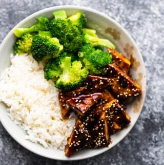 overhead view of teriyaki tofu in bowl with rice and broccoli