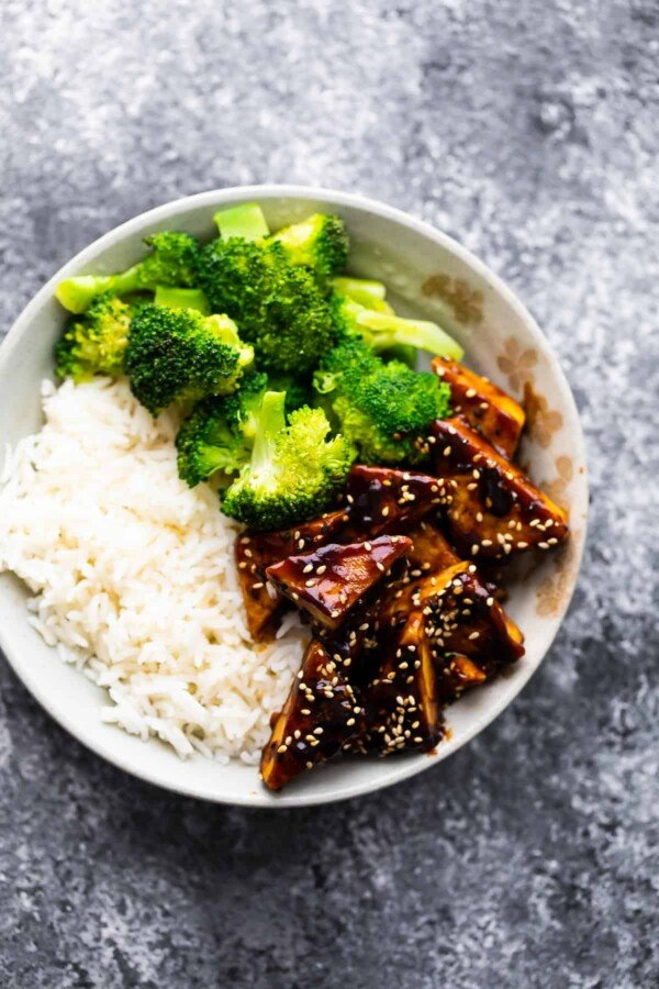 overhead view of teriyaki tofu in bowl with rice and broccoli