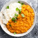 thai lentil curry in bowl with cilantro and rice